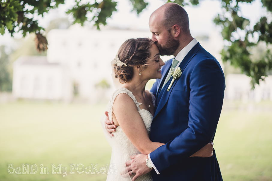 a beautiful moment between new husband and wife rockbeare manor