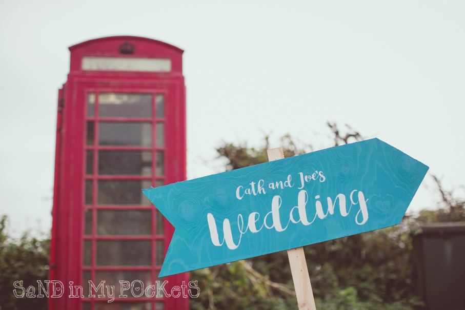 sign to cath and joes barn wedding mothecombe devon